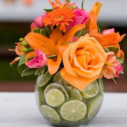 Use limes in your flower centerpieces.  See more on WomanGettingMarried.com