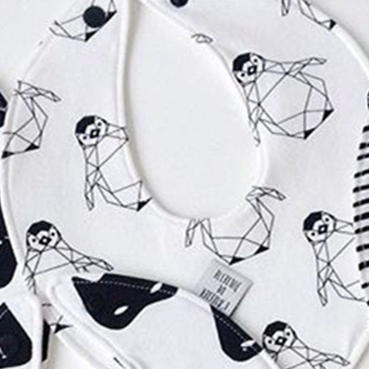 Ticking all the boxes here; Geometric, monochrome penguin cotton baby bibs. www.desa.life