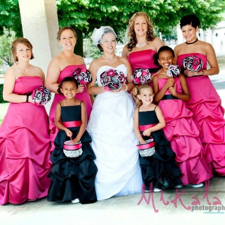 Black tablecloths surrounded by black ballroom chairs with white hot pink bridesmaids dresses and black flower girl dresses with flower bouquets mightylinksfo