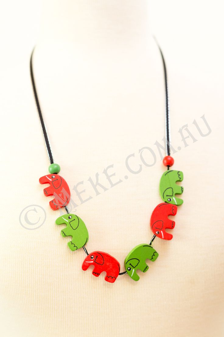 : : Elephant Parade Necklace : :  Your cheeky little monkey will look adorable in this handcrafted children's necklace featuring bright red and green timber elephant beads parading along a black and silver ribbon, with matching round timber beads at either end. Who needs the zoo!!  Visit my Etsy store for more info, or to purchase: https://www.etsy.com/au/listing/153864290/elephant-parade-childrens-necklace?ref=shop_home_active  Handmade with love and care by Marianne ❤