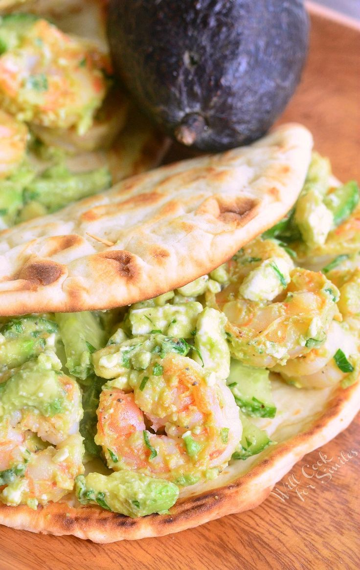 Amazing flatbread sandwich that's packed with sauteed shrimp, creamy avocado, crunchy cucumbers, and feta cheese crumbles. Perfect light sandwich that will leave you quite satisfied.