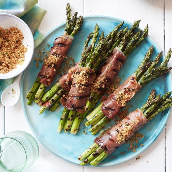 Prosciutto-Wrapped Asparagus with Lemony Bread Crumbs | Michael Chiarello cooks these asparagus twice: The first time early in the grilling session; the second time right before serving, after they're wrapped in prosciutto.