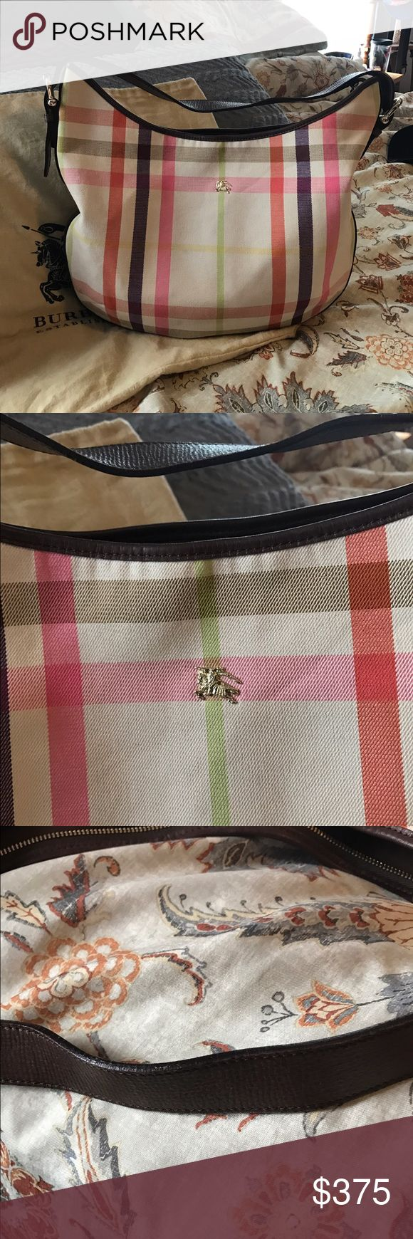 Authentic Burberry summer hobo Time to get ready for summer girls. This is the bag for you. Excellent condition. Has a couple of small dirt spots but can't see them unless your looking. No rips or tears. This is a very large bag. Comes with dust bag.  This is one of the best prices for this style on Poshmark Burberry Bags Hobos