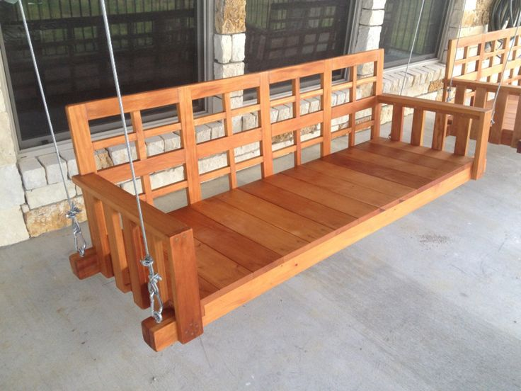 Swinging wooden picnic tables