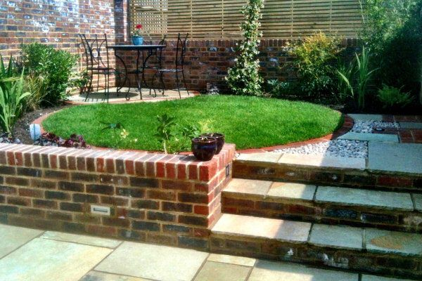 Apparently I like circles. This is a lovely example of a garden with 2 levels and a brick retaining wall.
