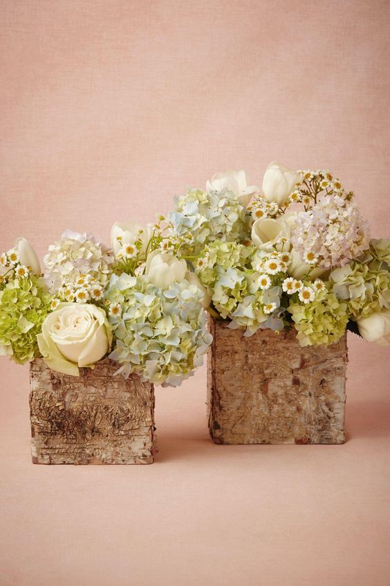 Pretty floral arrangements / http://www.deerpearlflowers.com/rustic-wedding-centerpieces-with-bark-container/