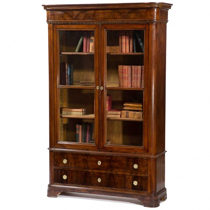 This antique glass-enclosed bookcase cabinet from northern Italy c. 1850 has elegant curved sides and a rich patina.