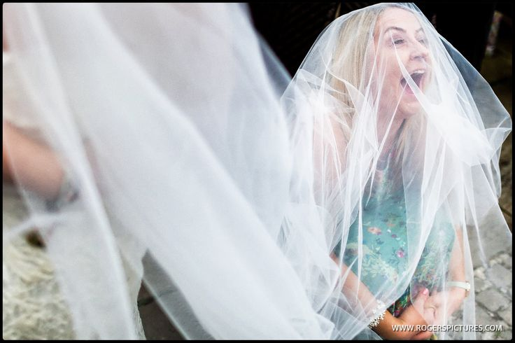A wedding guest enjoying Zoe and Robert's wedding at Notley Abbey -