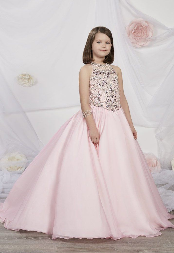 f5f5e074e2e Tiffany Princess 13534 is a pageant girl s ball gown that has a beautiful  bodice with a scoop neckline and rhinestone beading with sequins and pearls.
