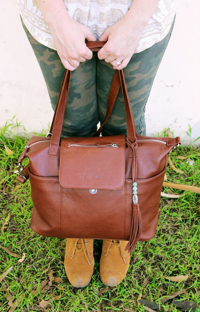 """""""this amazing designer diaper bag from Lily Jade…….it has the best compartments to organize everything, and doesn't even look like a diaper bag! I love how stylish it is!"""" http://lipglossandcrayons.com/2014/03/obsessed/"""