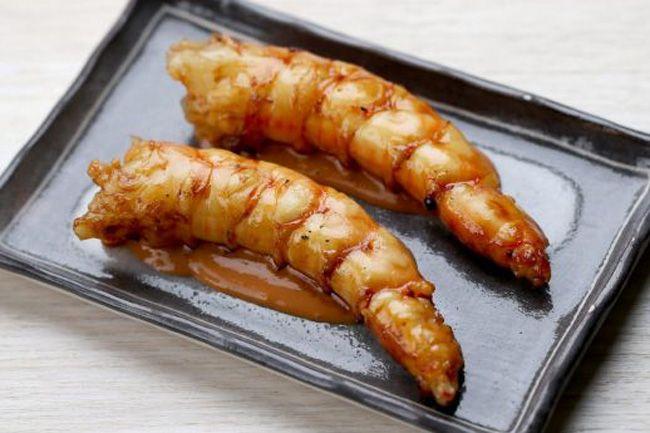 Grilled prawns served at Oter. Photo: Wayne Taylor