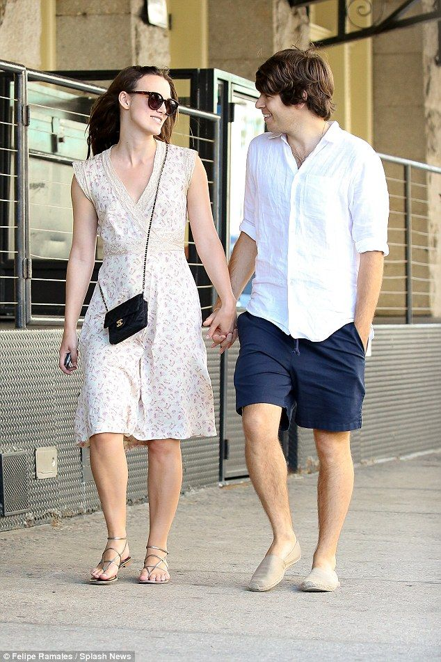 Loved up: Keira Knightley and husband James Righton can't take their eyes off each other as they stroll round New York on Wednesday