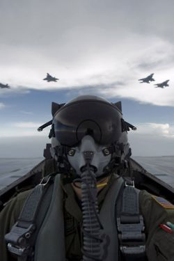 I have a million pics like this of my husband. I think it is a pilot thing to do!!