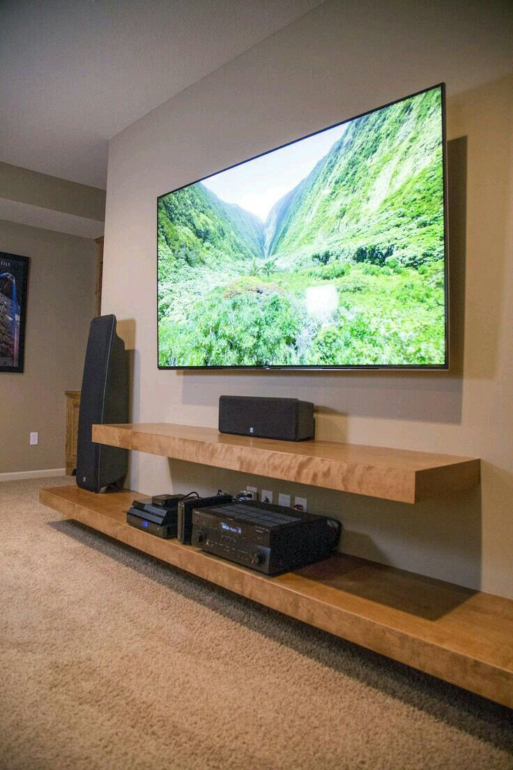 Thick wood entertainment unit shelves. Modern TV shelves. Modern ideas for TV wall mounting. Wood shelves below TV
