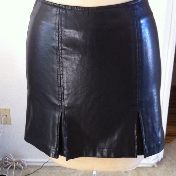 Black vinyl skirt Black vinyl skirt, with two pleats in front at bottom and zips up the back. XOXO Skirts Mini