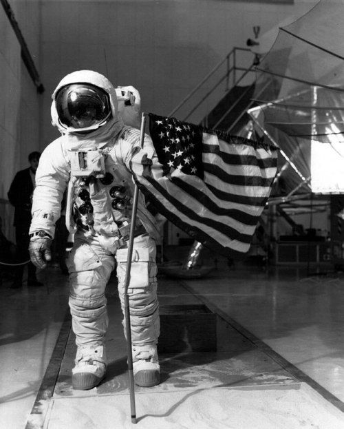 """humanoidhistory:  """"February 4, 1970 – Apollo 13 astronaut Jim Lovell practices flag deployment for a moon landing he'll never make.  """""""