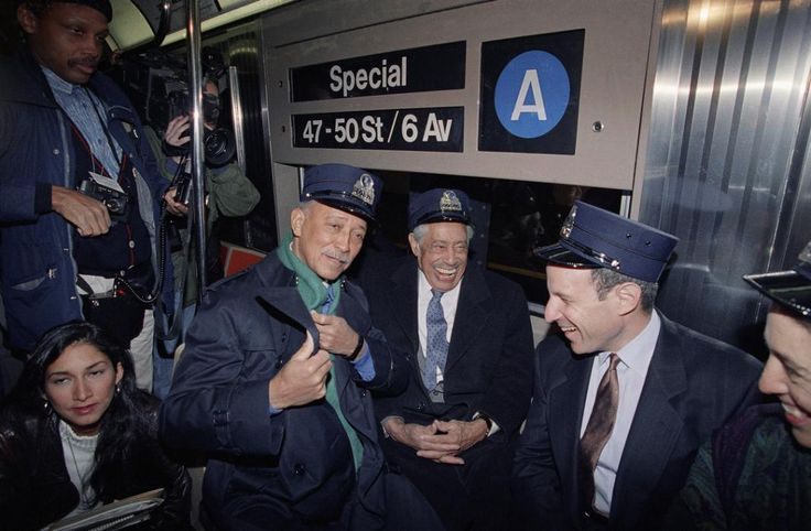 """Jazz great Cab Calloway, center, jokes with New York City Mayor David Dinkins, left, and Grammy organizer Jonathan Tisch, while riding a specially designated subway train from Harlem to Radio City Music Hall as part of the Grammy Week festivities in New York, Feb. 18, 1992. New York's subway system was immortalized in the Duke Ellington classic """"Take the 'A' Train"""