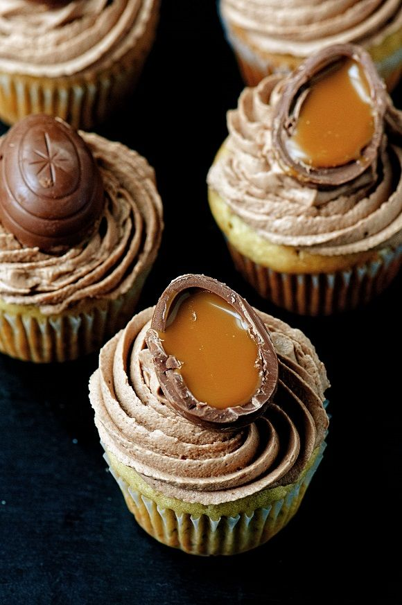 Cadbury Caramel Egg Banana Cupcakes: Banana Cupcakes topped with over the top amazingly good Cadbury Caramel Egg Frosting which literally has melted Cadbury Caramel Eggs in it.