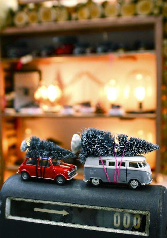 """Hahaha - I love the mini Christmas trees """"tied"""" to the top of the car and van!"""