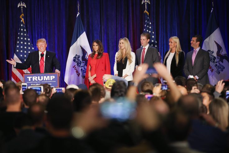Republican presidential candidate Donald Trump speaks at his Iowa Caucus night gathering while his wife Melania (2nd R-L), daughter-in-law Lara Yunaska, son Eric, daughter-in-law Vanessa Haydon, and son Donald Trump Jr. look on  February 1, 2016 in Des Moines, Iowa.   (Getty)