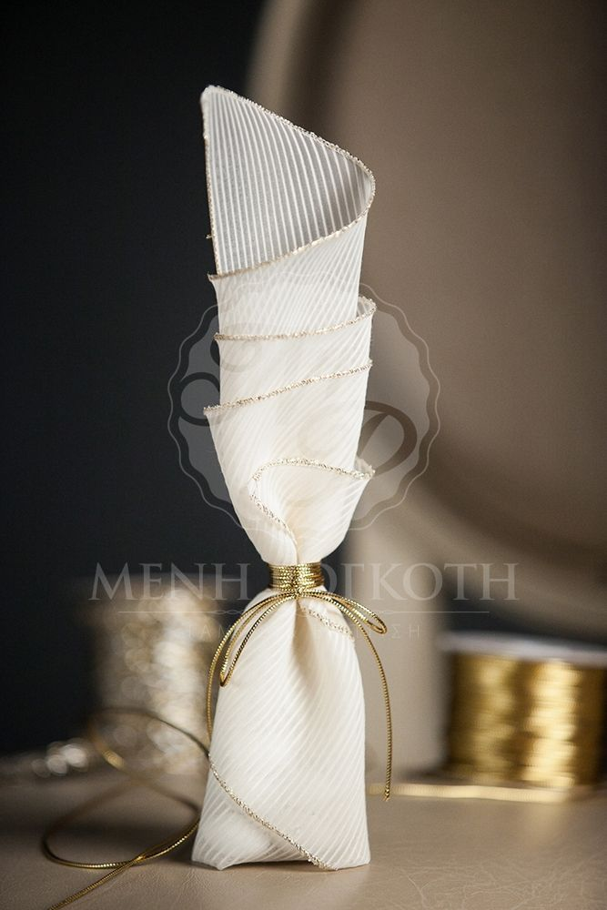Rib ivory fabric with gold trimming and gold cord wedding favor