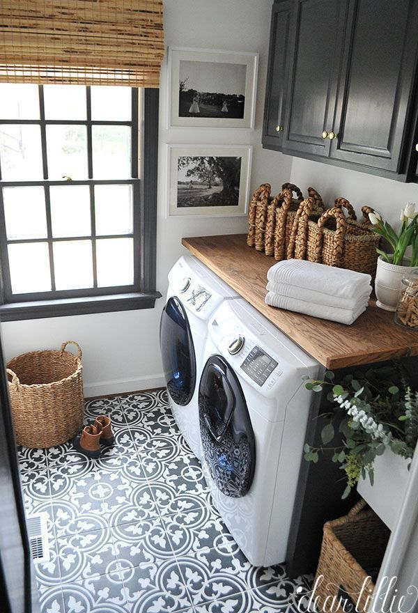 Laundry room inspiration. Bamboo blind. Wooden counter. Baskets for storage. Art on walls.