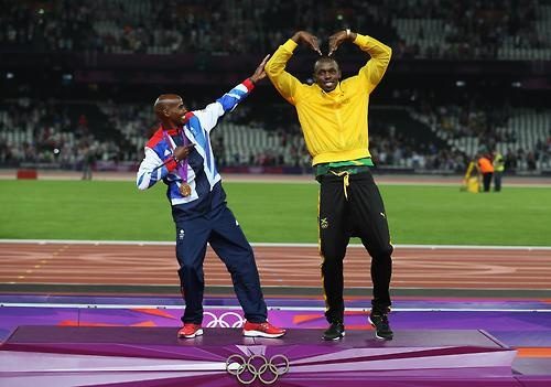 The two legends of the London 2012 track. Mo Farah (5000m, 10000m gold medalist) and Usain Bolt (100m, 200m, 4x100m relay gold medalist). Terrific stuff.