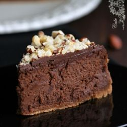 Wonderful, creamy chocolate- nutella cheesecake with hazelnuts (in Polish, translator in the sidebar)
