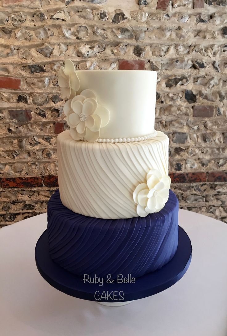 Beautiful Silk Pleats wedding cake design, in navy & ivory. We LOVE this cake!