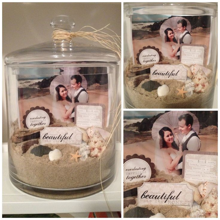 Photo jar using the sand, driftwood, rocks, etc from the beach where we were married, some cute craft cut outs from the craft store which have nice sayings on them and a wedding photo in a large jar