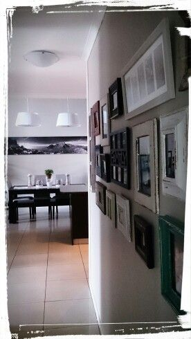 Photo wall to dining room. Our home.