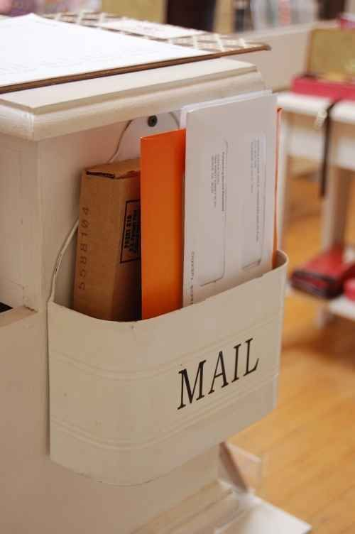 Hang your mail holder on the side of a table or kitchen counter.