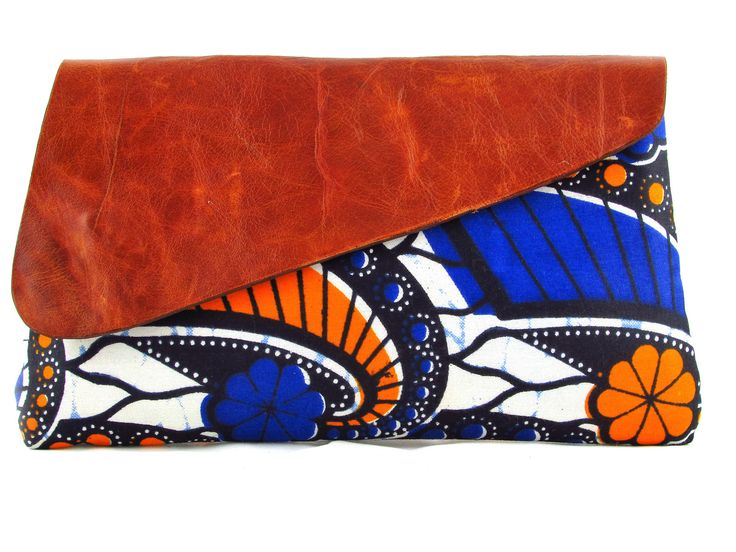 Nala, a gorgeous small clutch created with vibrant African fabrics and leather. Hand stitched by Handmade by FUNDI and brought to you by Modern Tradition - Where tradition meets today!