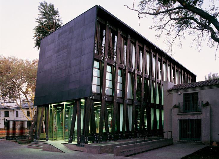 Laminated wood and glass façade of this Chilean office-building, PBIP Computers by Alberto Mozo #architecture
