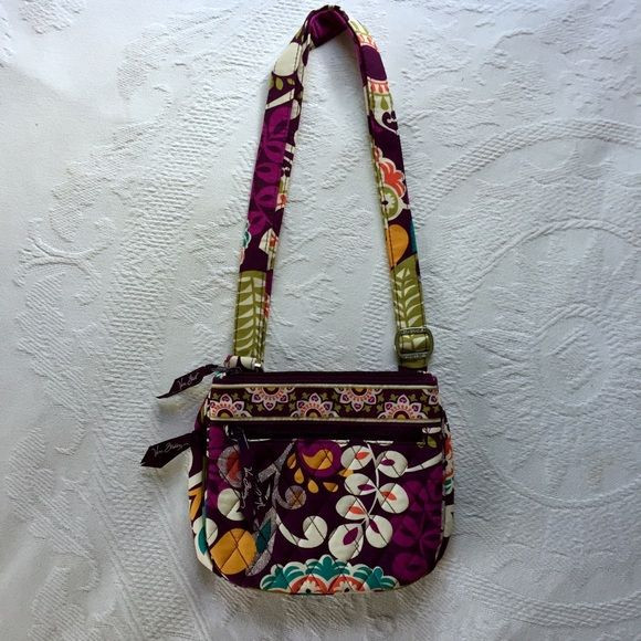 Vera Bradley Purse Purple Vera Bradley purse. Has zipper pocket, button pocket, and smaller zipper pocket on outside. Adjustable strap. Never used. Vera Bradley Bags Satchels