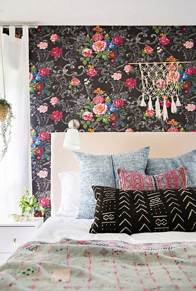 A bold and unexpected combination of floral themes and tribal prints is what makes this bohemian bedroom space especially compelling. Solid sheeting, headboard upholstery, and drapery allow the...