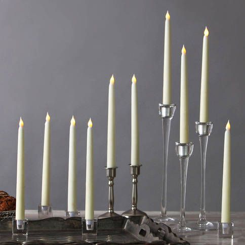 Set of 10 - Flameless Candles for a Candelabra.. a safe and easy alternative. Batteries come with! $35.00