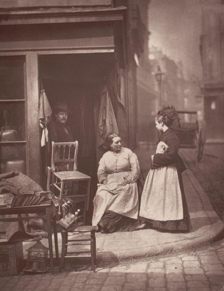 A Second hand furniture shop in London by John Thomson 1877: Check out the women's clothes and hat