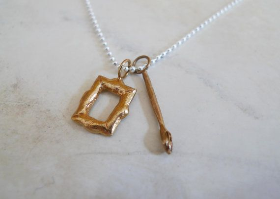 """Artist """"What I want to be"""" Necklace in Brass and Silver by Slashpile Designs. Artist frame and paintbrush charms are hand carved in wax and then cast in brass. They hang on an 18"""" sterling silver ball chain."""