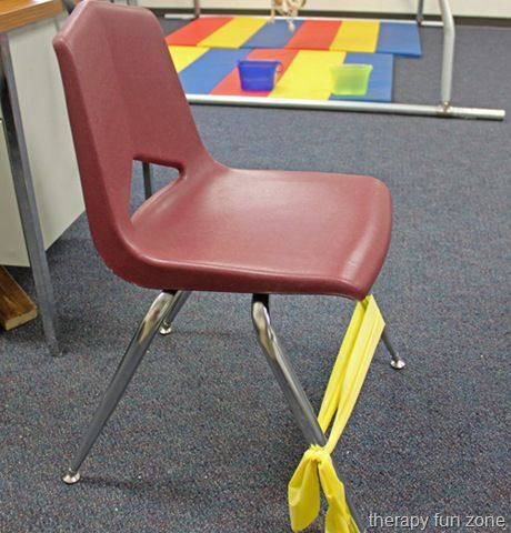 There is a simple trick that school therapists and teachers use a lot for kids who have trouble sitting still. It is to put some Thera-Band stretched around a chair's legs so that the student can push on it while sitting in their chair. It can help a child who has to be moving much of the time. The child can push on it with their feet so that they are moving while sitting at their desk doing work.