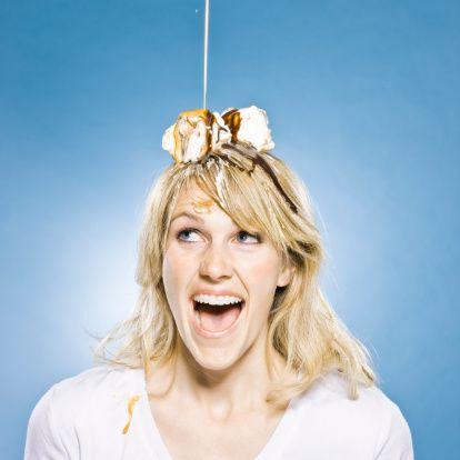 Stock Photo : woman with an ice cream sundae on her head