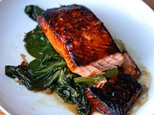 Honey-Soy Glazed Salmon  Mix together 2 tbs of Dijon, 2 tbs of Soy sauce, 2 tbs of honey, 1 1/4 tbs of lime juice, red chillies.  sprinkle salt and pepper, parsely, all over the salmon. pour mixture over salmon let marinate 2hrs or overnight. In frying pan pour olive oil, place salmon in pan, MAKE sure They don't stick.Pour extra left over mixture onto salmon. It's ready in 7-10 mins.