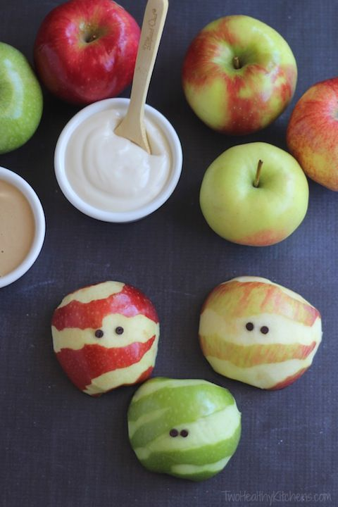 Peel apples to look like mummies. A great way for us mommies to get our kids (and ourselves…) to eat their apple a day!