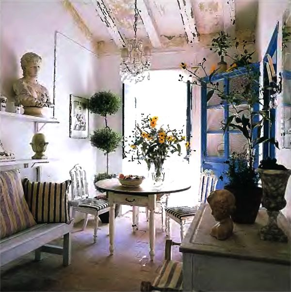 french style room decor, blue, white, beamed ceiling, wood bench, very rustic