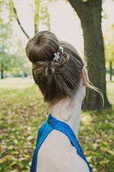 #Bridal and #bridesmaid #hairstyles by Allene Chomyn Hair Design. High #bun with hair accessories.