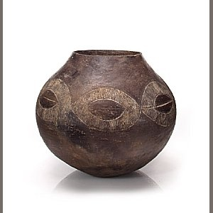 Zulu Beer Vessel, South Africa  height 8 1/2in (21.6cm)   of spherical form with slightly tapered opening; glistening black surface highlighted with a circular pattern of incisions.     Provenance:   Fred Jahn, Munich   Private American Collection