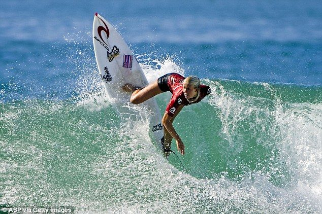 Fearless: Bethany is pictured on her surfboard competing at the ISA Lost Energy Drink World Surfing Games in 2006 - three years after she nearly died when she was attacked by a shark while surfing with her family