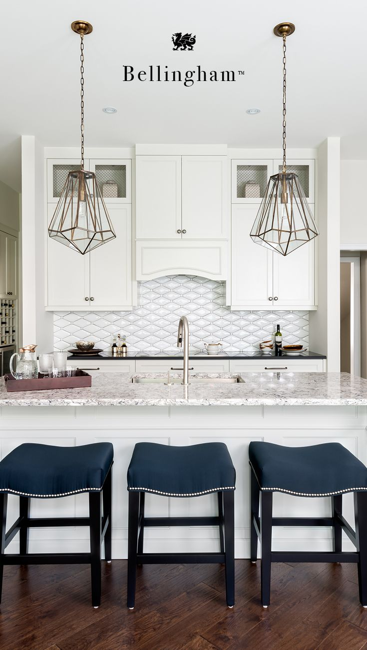 This large Cambria Bellingham island is ideal for entertaining and hosting. Bellingham is a beautiful granite alternative that is more durable, easier to clean, and stain resistant. This natural quartz countertop island is white and cream based with black and navy movement.