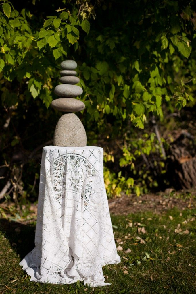 """You could make a """"unity cairn"""" rather than having a candle or sand ceremony."""