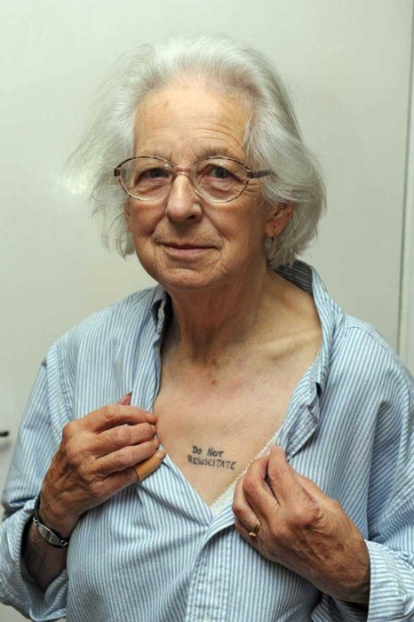 """Serious ink!    81-year-old Joy Tomkins wanted to make sure no one tried to bring her back from the dead, so she did what any normal grandmother of six would do: She had """"Do Not Resuscitate"""" tattooed on her chest.    """"I do not want to be half dead, I want to be fully dead,"""" said Tomkins, who suffers from arthritis, Reynard's disease, and diabetes. """"I'm afraid the medical profession will, with the best of intentions, keep me alive when I don't want to be alive."""": Glasses Flowers, Ideas, First Tattoo, I'M Afraid, Mean Tattoo, A Tattoo, Flowers Vase, Ink, Smart Women"""